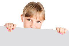 Cute preteen girl hiding behind banner. Cute preteen girl holding a banner isolated over a white background Stock Photos