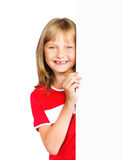 Cute preteen girl looking out vertical banner. Isolated over a white background Stock Image