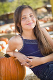 Cute Preteen Girl Portrait at the Pumpkin Patch. Preteen Girl Portrait at the Pumpkin Patch in a Rustic Setting Stock Photography