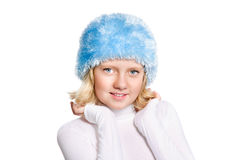 Cute preteen girl wearing blue hat. Isolated over white. The winter concept Stock Photography