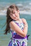 Cute preteen long hair girl on riverbank Stock Image