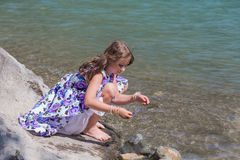 Cute preteen long hair girl on riverbank Stock Images