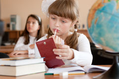 Cute preteen schoolgirl is making make-up during l Stock Image