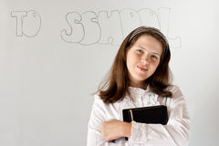 Cute preteen schoolgirl portrait near whiteboard Royalty Free Stock Photos