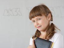 Cute preteen schoolgirl portrait near whiteboard Royalty Free Stock Photo