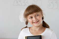 Cute preteen schoolgirl portrait near whiteboard Royalty Free Stock Image