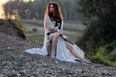 Girl with spear at the river royalty free stock image