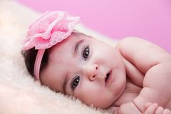 Cute, pretty, happy, chubby baby girl portrait, without clothes, naked or nude, on a fluffy blanket. Stock Photography