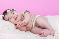 Cute, pretty, happy, chubby and smiling baby girl, laughing with a big smile. Royalty Free Stock Image