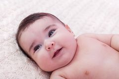 Cute, pretty, happy, chubby and smiling baby girl portrait. Royalty Free Stock Photography