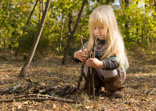 Cute pretty little girl building a wigwam Royalty Free Stock Image