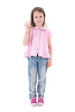 Cute pretty little girl showing ok sign isolated on white. Background Stock Image