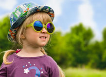 Cute pretty little girl in trendy summer fashion Stock Image