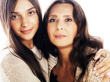 Cute pretty teen daughter with mature mother hugging, fashion st stock image