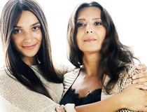 Cute pretty teen daughter with mature mother hugging, fashion st. Yle brunette, lifestyle people concept close up royalty free stock photos