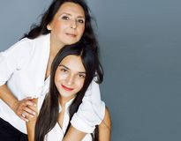 Cute pretty teen daughter with mature mother hugging, fashion st. Yle brunette, lifestyle people concept close up stock photos