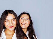 Cute pretty teen daughter with mature mother hugging, fashion st Royalty Free Stock Photos