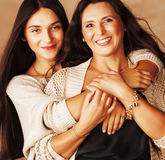 Cute pretty teen daughter with mature mother hugging, fashion st Stock Images