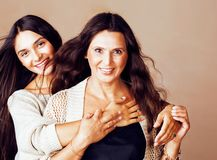 Cute pretty teen daughter with mature mother hugging, lifestyle people concept. Closeup stock photos