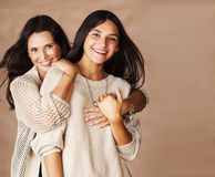 Cute pretty teen daughter with mature mothr hugging, fashion style brunette stock images