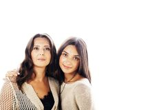 Cute pretty teen daughter with real mature mother hugging, fashi. On style brunette makeup close up tann s, warm colors isolated on white background, lifestyle royalty free stock image