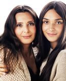 Cute pretty teen daughter with real mature mother hugging, fashi. On lifestyle people isolated on white background stock image