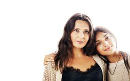 Cute pretty teen daughter with real mature mother hugging, fashi stock photos
