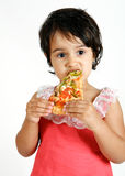 Cute and pretty toddler eating pizza slice Royalty Free Stock Image