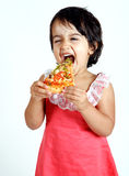 Cute and pretty toddler eating pizza slice Stock Photo
