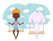 Cute prince and rabbit on a swing Royalty Free Stock Images