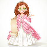 Cute princess with curly brown hair hold sheet of parchment Stock Photos