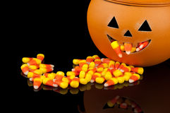Cute Pumpkin with Candy Corn Stock Images