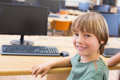 Cute pupil in computer class. At the elementary school Royalty Free Stock Images