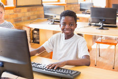 Cute pupil in computer class Royalty Free Stock Photos