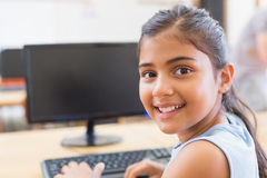 Cute pupil in computer class Royalty Free Stock Image