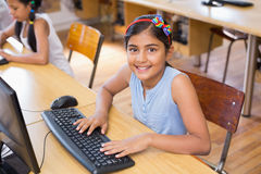 Cute pupil in computer class Royalty Free Stock Photography