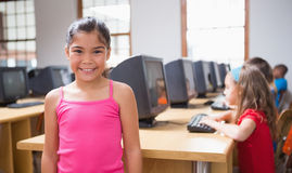 Cute pupil in computer class smiling at camera Royalty Free Stock Photo
