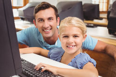 Cute pupil in computer class with teacher Royalty Free Stock Photography