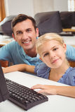Cute pupil in computer class with teacher Stock Photography