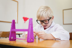 Cute pupil dressed up as scientist in classroom. At the elementary school royalty free stock photos