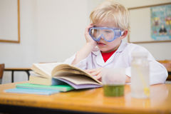 Cute pupil dressed up as scientist in classroom. At the elementary school royalty free stock image
