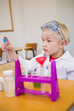 Cute pupil dressed up as scientist in classroom. At the elementary school stock image
