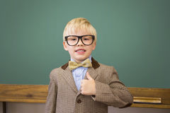 Cute pupil dressed up as teacher in classroom Stock Images