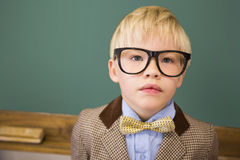 Cute pupil dressed up as teacher in classroom. At the elementary school royalty free stock photography