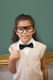 Cute pupil dressed up as teacher in classroom Royalty Free Stock Photo
