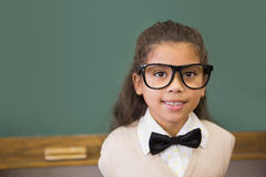 Cute pupil dressed up as teacher in classroom Royalty Free Stock Photography