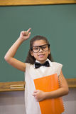 Cute pupil dressed up as teacher in classroom Royalty Free Stock Images