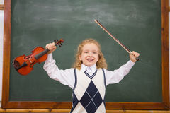 Cute pupil holding violin and violin string Royalty Free Stock Image