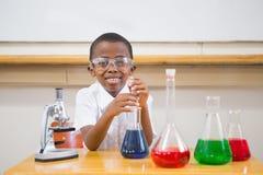 Cute pupil looking at liquids Royalty Free Stock Image