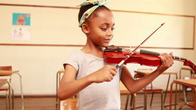Cute pupil playing violin in classroom. At the elementary school stock video footage
